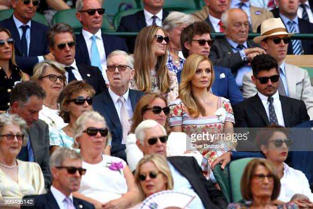 Anna Eberstein Hugh Grant Hannah Bagshawe Eddie Redmayne and Benedict Cumberbatch sit behind Katherine Jenkins and Andrew Levitas as they attend the...