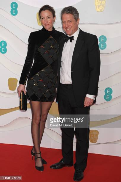 Anna Elisabet Eberstein and Hugh Grant arrive at the EE British Academy Film Awards 2020 at Royal Albert Hall on February 2, 2020 in London, England.
