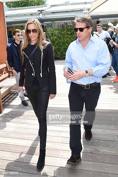 Anna Elisabet Eberstein and Hugh Grant attend the 2016 French tennis Open day Four at Roland Garros on May 25 2016 in Paris France