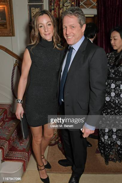 Anna Elisabet Eberstein and Hugh Grant attend the Charles Finch CHANEL PreBAFTA Party at 5 Hertford Street on February 1 2020 in London England