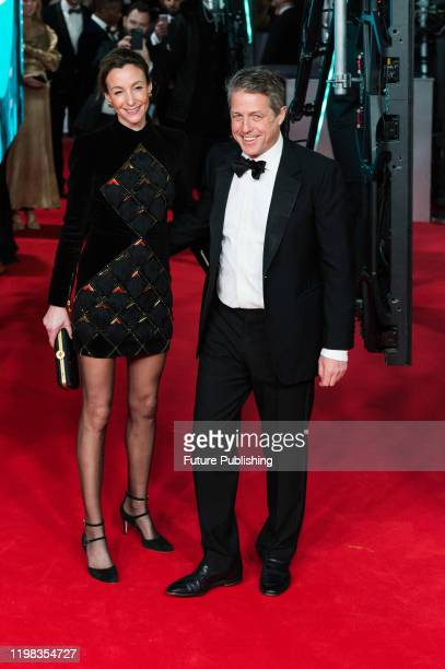 Anna Elisabet Eberstein and Hugh Grant attend the EE British Academy Film Awards ceremony at the Royal Albert Hall on 02 February 2020 in London...