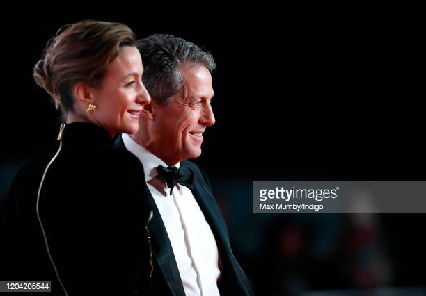 Anna Elisabet Eberstein and Hugh Grant attend the EE British Academy Film Awards 2020 at the Royal Albert Hall on February 2 2020 in London England