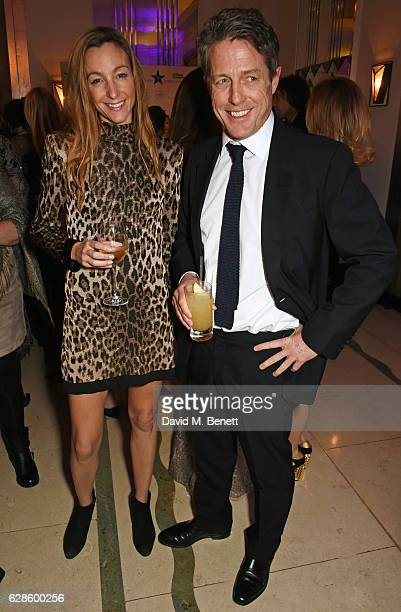 Anna Elisabet Eberstein and Hugh Grant attend The London Evening Standard British Film Awards at Claridge's Hotel on December 8 2016 in London England
