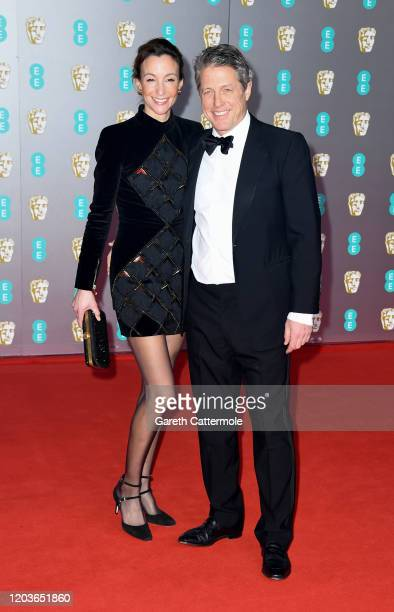 Anna Elisabet Eberstein and Hugh Grant attends the EE British Academy Film Awards 2020 at Royal Albert Hall on February 02 2020 in London England
