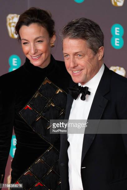 Anna Elisabet Eberstein Hugh Grant attend the EE British Academy Film Awards 2020 at Royal Albert Hall on February 02 2020 in London England