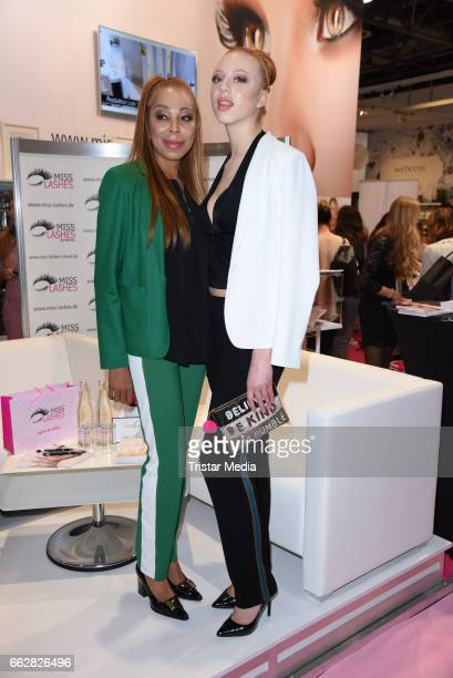 Anna Ermakova and her mother Angela Ermakova visit 'Miss Lashes' lashes lounge at the Beauty Top Hair Fair on April 1 2017 in Duesseldorf Germany