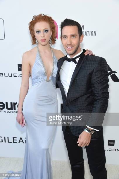 Anna Ermakova and Marcel Remus attend the 27th annual Elton John AIDS Foundation Academy Awards Viewing Party sponsored by IMDb and Neuro Drinks...