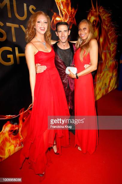 Anna Ermakova her mother Angela Ermakova and Marcel Remus during the Remus Lifestyle Night on August 2 2018 in Palma de Mallorca Spain