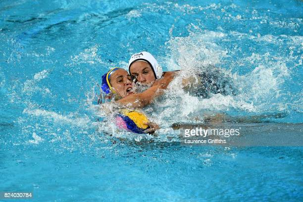 Anna Espar Llaquet of Spain and Kiley Neushul of United States compete for the ball during the Women's Water Polo gold medal match between the United...