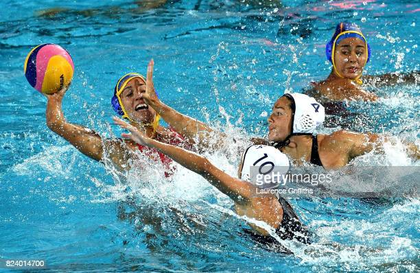 Anna Espar Llaquet of Spain is closed down by Rachel Fattal and Jamie Neushul of the United States during the Women's Water Polo gold medal match...