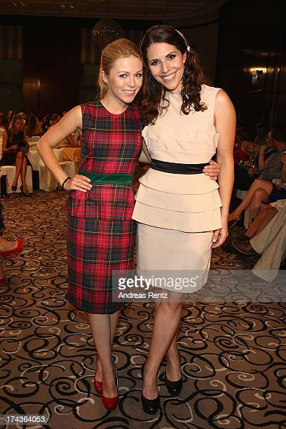 Anna Ewelina and EvaMaria Reichert attend the Marcel Ostertag fashion show at Charles Hotel on July 24 2013 in Munich Germany