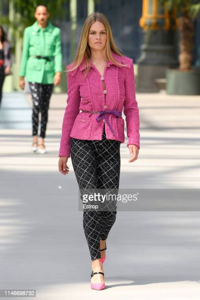 Anna Ewers walks the runway during Chanel Cruise 2020 Collection at Le Grand Palais on May 3 2019 in Paris France