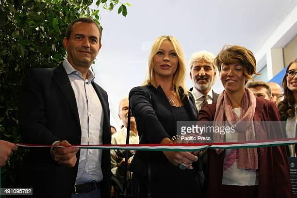 Anna Falchi and Mayor Luigi De Magistris cut the ribbon during the inauguration of salon Bomboniera del Regalo e della Casa