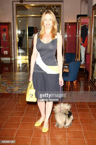 Anna Falchi poses with her dog Lana on July 11 2007 in Ischia Italy