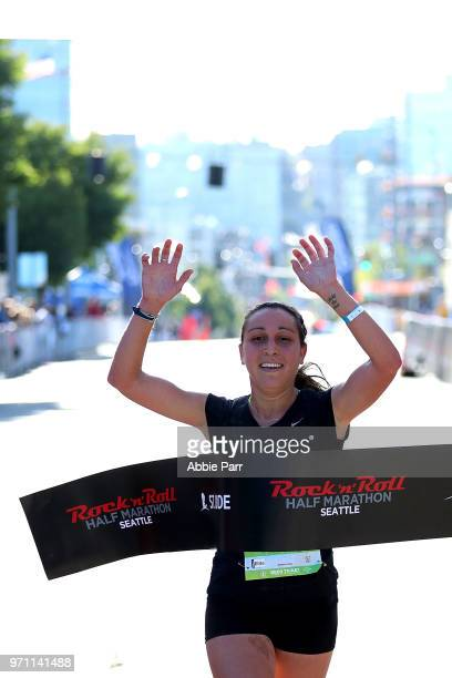 Anna Farello crosses the finish line to finish first in the Women's 1/2 Marathon during the St Jude Rock 'n' Roll Seattle Marathon 1/2 Marathon on...