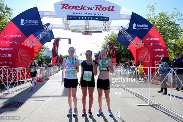 Anna Farello Jen Moroz and Bridget End stand at the finish line after finishing as the top three in the Female 1/2 Marathon during the St Jude Rock...