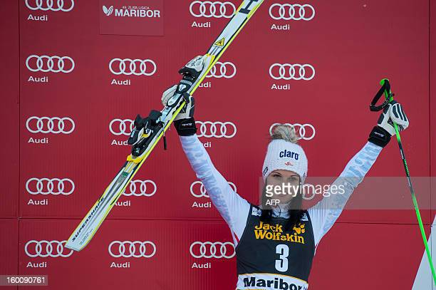 Anna Fenninger of Austria celebrates on the podium after winning bronze during the FIS World Cup women's giant slalom in Maribor Slovenia on January...