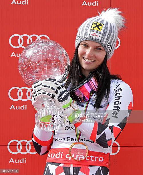 Anna Fenninger of Austria poses with the crystal globe for the overall title after the FIS Alpine Ski World Cup women's giant slalom race on March 22...