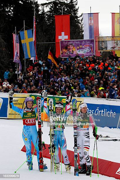 Anna Fenninger of Austria takes 1st place Tina Maze of Slovenia takes 2nd place Viktoria Rebensburg of Germany takes 3rd place during the Audi FIS...