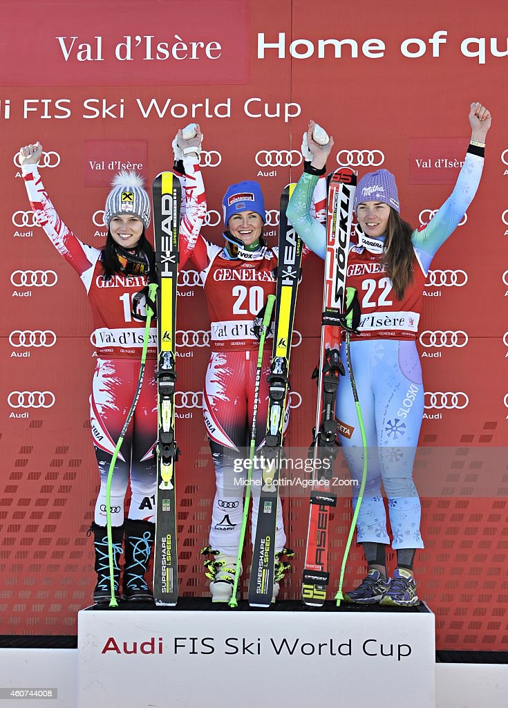 Anna Fenninger of Austria takes 2nd place, Elisabeth Goergl of Austria takes 1st place, Tina Maze of Slovenia takes 3rd place during the Audi FIS Alpine Ski World Cup Women's Super-G on December 21, 2014 in Val d'Isere, France.