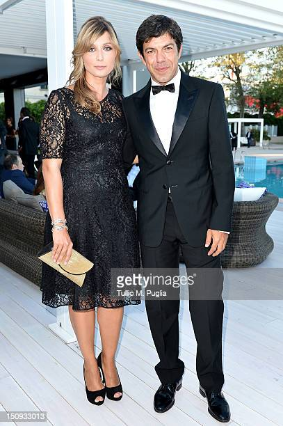 Anna Ferzetti and Pierfrancesco Favino attend the Lancia Cafe Hosts 'The Reluctant Fundamestalist' Cocktail on August 29 2012 in Venice Italy