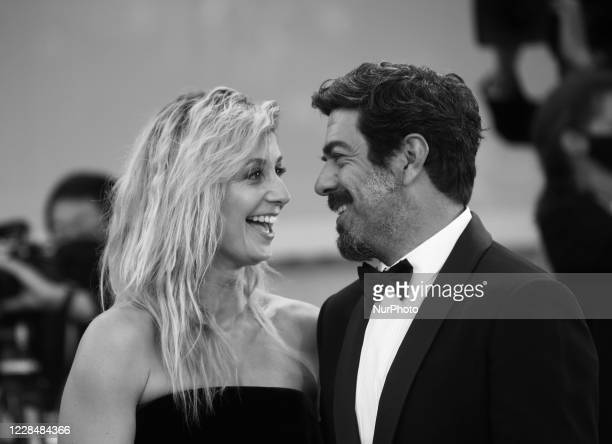 Image was converted to black and white) Anna Ferzetti, Pierfrancesco Favino walk the red carpet ahead of closing ceremony at the 77th Venice Film...