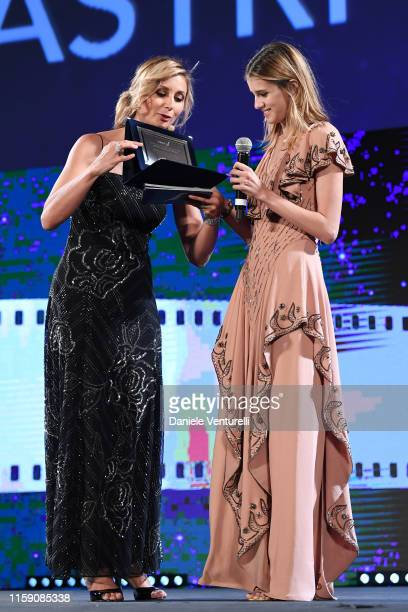 Anna Ferzetti presents Benedetta Porcaroli an award on stage at the Nastri D'Argento awards ceremony in Taormina on June 29 2019 in Taormina Italy