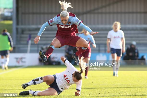 Anna Filbey of Tottenham Hotspur Women slide tackling Adriana Leon of West Ham United Women during the Barclays FA Women's Super League match between...