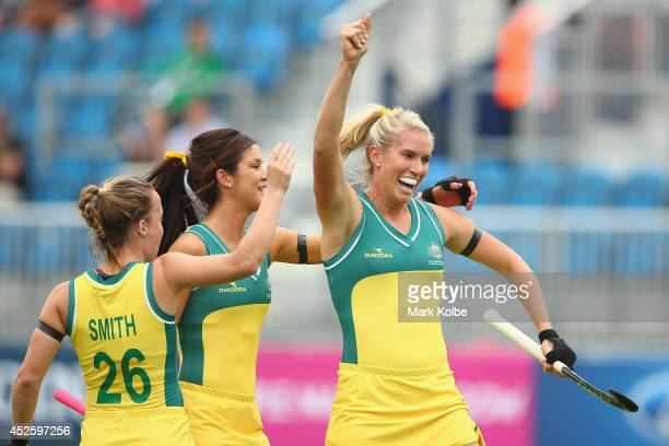 Anna Flanagan celebrates scoring a goal during the Women's preliminary match between Australia and Malaysia at Glasgow National Hockey Centre during...