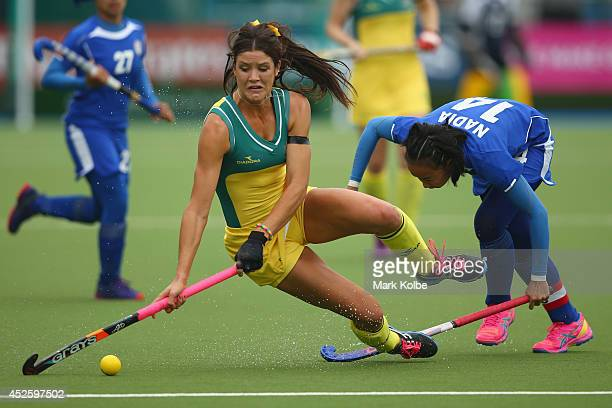 Anna Flanagan of Australia falls as she is tackled during the Women's preliminary match between Australia and Malaysia at Glasgow National Hockey...