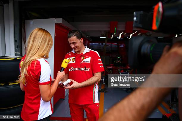 Anna Fleischhauer of RTL TV is given a Shell fuel sample from a Shell fuel technician during the Formula One Grand Prix of Germany at Hockenheimring...