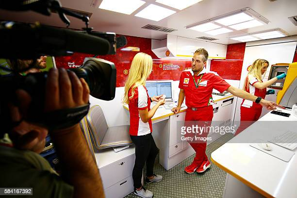 Anna Fleischhauer of RTL TV is shown around the Shell Track Lab by a Shell fuel technician during the Formula One Grand Prix of Germany at...