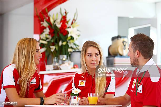 Anna Fleischhauer of RTL TV talks to Jennifer Plueckhahn and Marcel Ehlert both of Shell during the Formula One Grand Prix of Germany at...