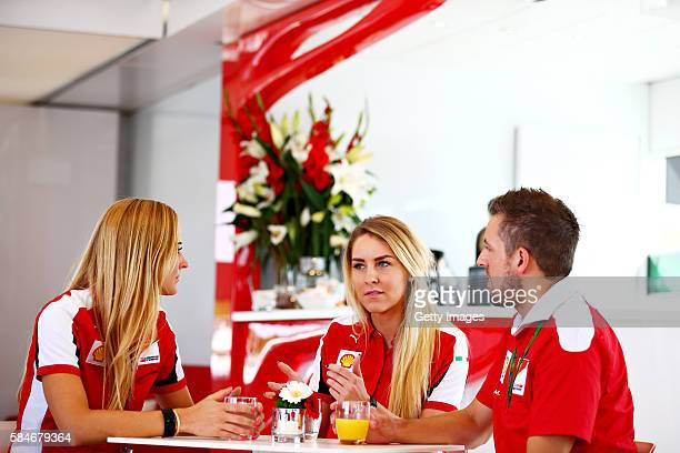 Anna Fleischhauer of RTL TV talks to Jennifer Plueckhahn and Marcus Ehlert both of Shell during the Formula One Grand Prix of Germany at...