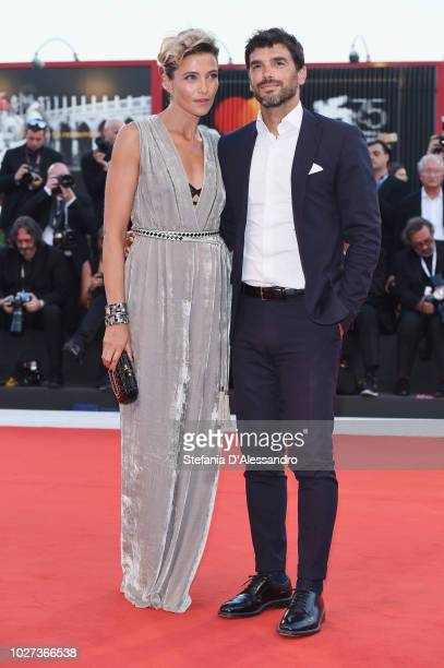 Anna Foglietta and Paolo Sopranzetti walk the red carpet ahead of the '22 July' screening during the 75th Venice Film Festival at Sala Grande on...