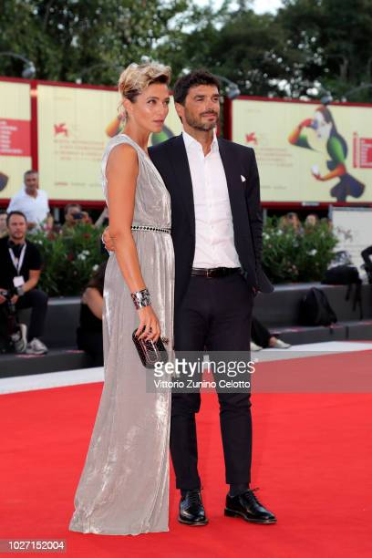 Anna Foglietta and Paolo Sopranzetti walks the red carpet ahead of the '22 July' screening during the 75th Venice Film Festival at Sala Grande on...