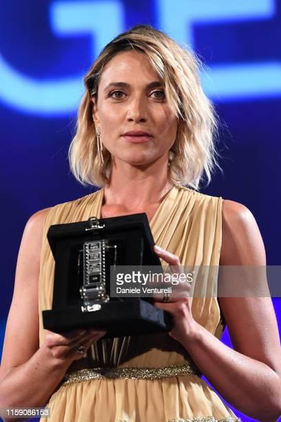 Anna Foglietta poses on stage at the Nastri D'Argento awards ceremony in Taormina on June 29 2019 in Taormina Italy