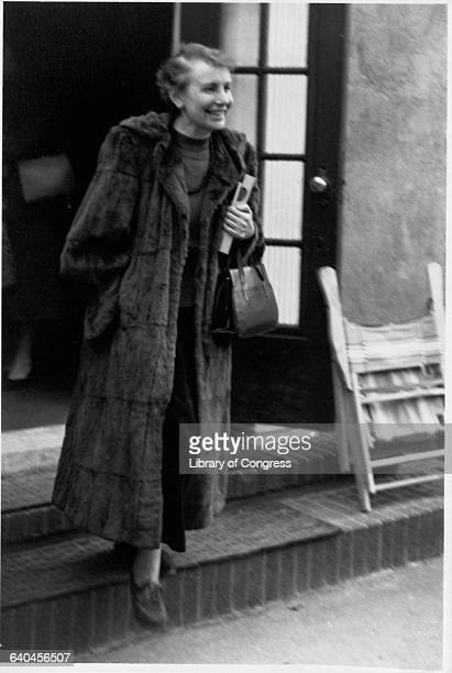 Anna Freud pioneer of child psychoanalysis emerges from a doorway wearing a fur coat