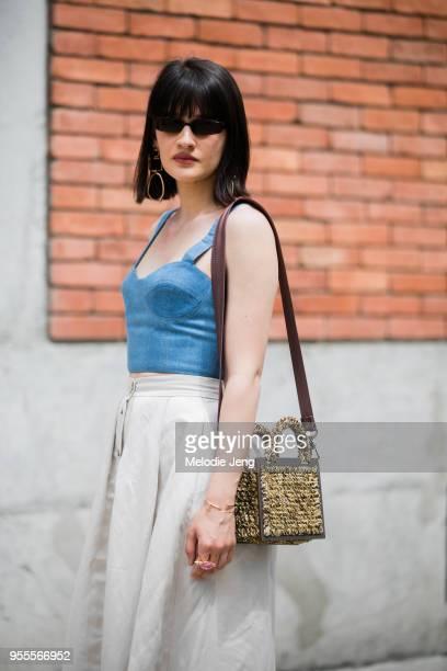 Anna Gagua wears a Dots denim bra Dots beige skirt Nina Zarqua shoes SevenEleven handbag and brown heels at MercedesBenz Fashion Week Tbilisi FW18 on...