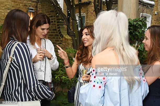 Anna Gardner Lily Pebbles Amelia Liana and Victoria Magrath attend an intimate dinner hosted by Tanya Burr to launch her first cookbook 'Tanya Bakes'...