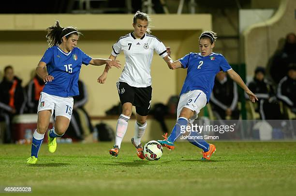 Anna Gasper of Germany and Valentina Bergamaschi and Lisa Boattin of Italy fight for the ball during the women's U19 international friendly match...