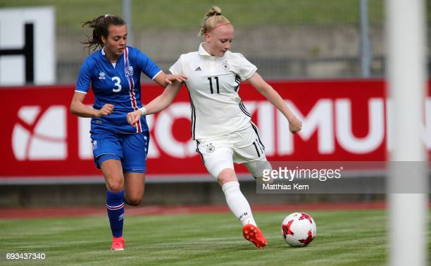 Anna Gerhardt of Germany battles for the ball with Droefn Einarsdottir of Iceland during the U19 women's elite round match between Germany and...
