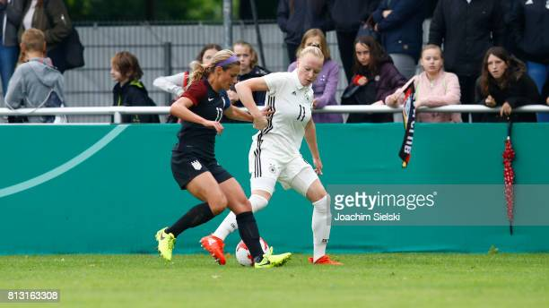 Anna Gerhardt of Germany challenges Emily Fox of USA during the international friendly match between U19 Women's Germany and U19 Women's USA at OBI...