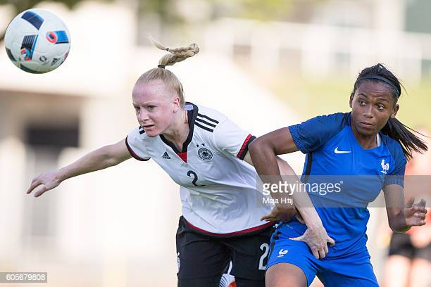 Anna Gerhardt of Germany is challenged by Perle Morroni of France during the Germany U20 Women's v France U20 Women's International Friendly Match on...