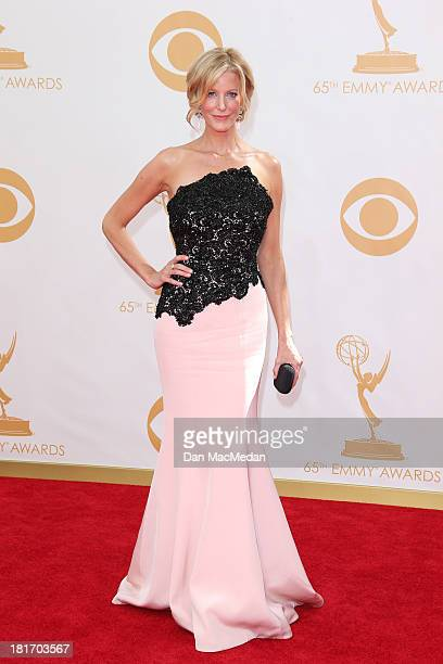Anna Gunn arrives at the 65th Annual Primetime Emmy Awards at Nokia Theatre LA Live on September 22 2013 in Los Angeles California