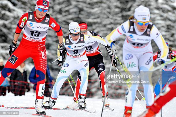Anna Haag of Swede and Marthe Kristoffersen of Norway ski during the FIS CrossCountry World Cup Women's 15 km Mass Start on December 18 2010 in La...