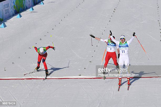 Anna Haag of Sweden takes 2nd place Justyna Kowalczyk of Poland takes 3rd place and Kristin Stoermer Steira of Norway during the Ladies' 15 km...