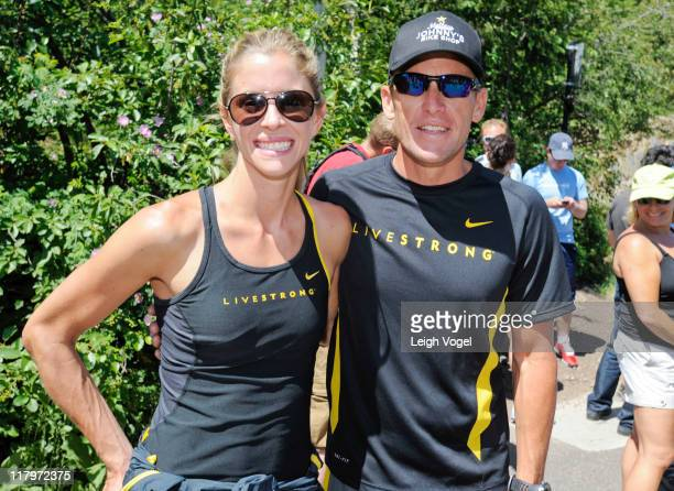 Anna Hansen and Lance Armstrong greet people at the base of Ute Trail after Armstrong tweets his intent to climb the 22 mile trail during the Aspen...