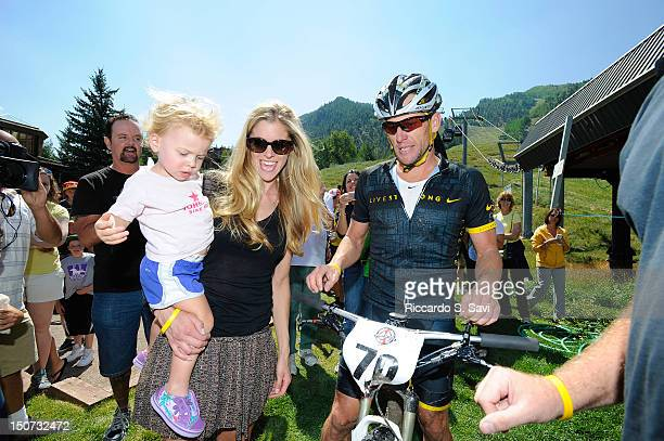 Anna Hansen Armstrong and Lance Armstrong meet after the Power of Four Mountain Bike Race on Aspen Mountain on August 25 2012 in Aspen Colorado