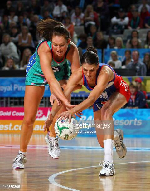 Anna Harrison of the Mystics and Kate Beveridge of the Vixens compete for the ball during the round eight ANZ Championship match between the...